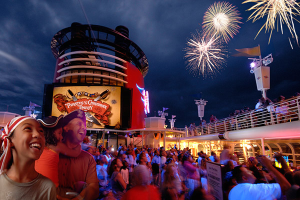 Guests enjoy Pirate Night, including Fireworks, during their Disney Cruise.