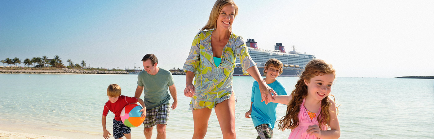 A family enjoys the beach on Disney's private island, Castaway Cay.